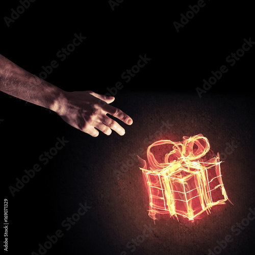 Concept of celebration with fire burning gift symbol and creatio