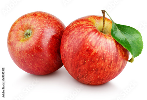 Leinwanddruck Bild Two ripe red apple fruits with green leaf isolated on white background. Red apples with clipping path