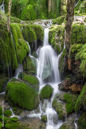 Fotobehang Betoverde Bos Toberia Waterfalls at Entzia mountain range, Basque Country, Spain