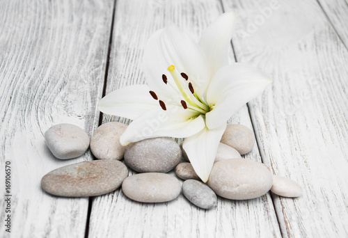 Fotobehang Spa White lily and massage stones