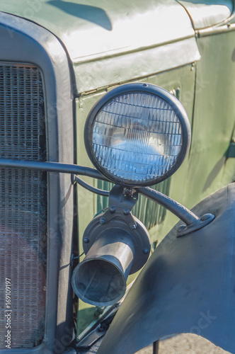 military retro car, headlight and signal.