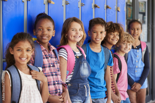 School kids in front of lockers in elementary school hallway