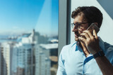 Closeup of a business investor talking on phone. - 169125954