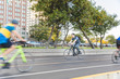 Man cycling in the Chicago city, panning