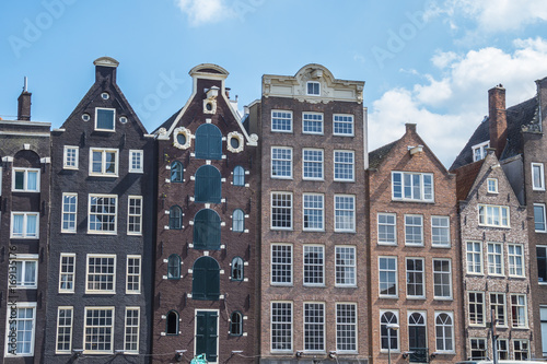Foto op Plexiglas Amsterdam The typical small buildings along the canals in the city center of Amsterdam