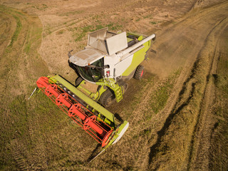 High Angle View  modern combine harvester  at the harvesting the wheat -  Cereal harvest