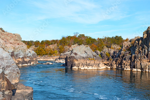 Potomac River in Great Falls Park in autumn, Virginia, USA. Scenic view on river waters and mountainous banks.