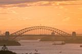 Sydney Harbour Bridge view in warm sunset time.