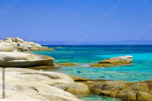 Sea coast under blue sky