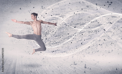 Performance ballet dancer jumping with energy explosion particles