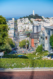 SAN FRANCISCO - AUGUST 7TH, 2017 - Tourists in Lombar Street. It is claimed as the most crooked street in the world, located along the eastern segment in the Russian Hill neighborhood - 169175163
