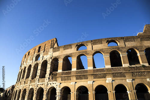 Part of the wall of Colosseum (Coliseum) in Rome, Italy at sunset Poster