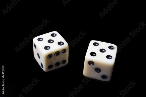 Poster Dice on a black background - selective focus