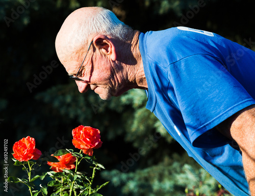 Lifestyle: Active Elderly Man Stopping to Smell the Roses