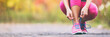 Leinwanddruck Bild - Running shoes runner woman tying laces for autumn run in forest park panoramic banner copy space. Jogging girl exercise motivation heatlh and fitness.