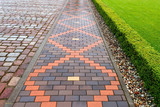Beautiful pavement of red and brown clinker brick. Walking path - 169256925