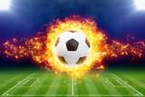 Fototapeta Fototapety na ścianę do pokoju dziecięcego - Burning soccer ball above green football stadium © Ig0rZh