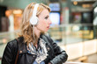 Woman listening music in a public place