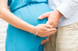 Man touching his pregnant wife belly