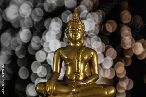 Fotobehang Boeddha Amazing golden buddha with bokeh background, symbol of peace, meditation and enlightenment