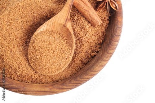 Poster Kruiden 2 Wooden bowl and spoon with sweet cinnamon sugar on white background