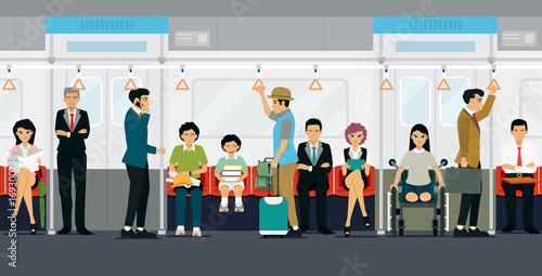 People stand and sit on the subway train.
