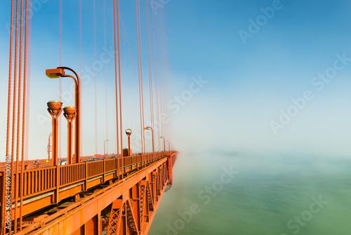 Fotobehang San Francisco Fog over San Francisco. Part of the famous Golden Gate Bridge. The ocean coast near San Francisco, California.