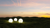 three glowing spheres illumination a garden at sunset 3d rendering - 169311574