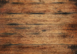Old aged brown wooden planks background texture