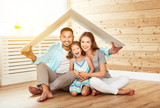 Fototapety concept housing   young family. Mother father and child in new house with  roof