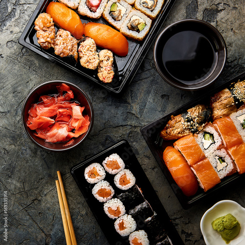 Aluminium Sushi bar Variation of sushi and rolls on stone table. Sushi rolls, sashimi set with chopsticks. Top view with copy space.
