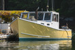 Lobster boat docked for unloading in early autumn in South Bristol, Maine, United States