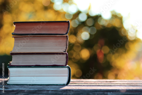 autumn book stack wooden outdoor - 169368500
