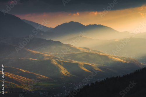 Fotobehang Herfst Majestic sunset light lay on a mountain hills