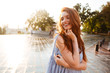 Pretty young redhead girl with long hair laughing - 169386351