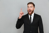 Excited young bearded businessman having an idea
