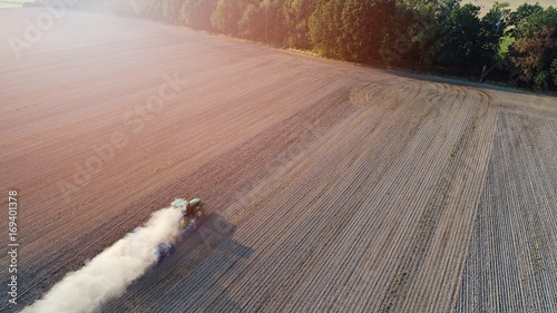 Fotobehang Trekker Aerial view on tractor ploughing field.