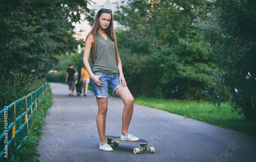 Fotobehang Skateboard Beautiful young woman with skateboard