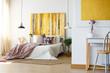 Energetic bedroom with yellow artwork