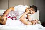 Lovely young couple in the bed - 169442774