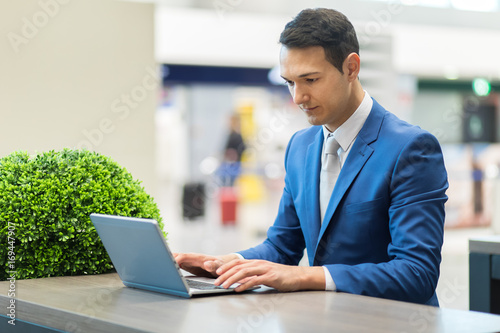 Young businessman using his laptop