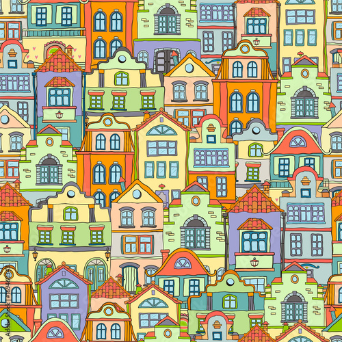 Seamless pattern with doodles colored scandinavian houses . Vector colored background .