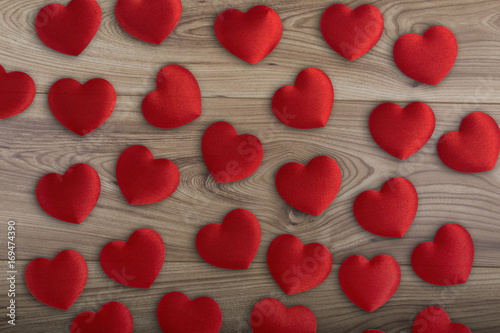 Fotobehang Rood paars Red fabric rose petals on a wood background