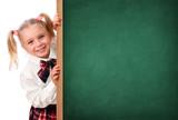 Little Schoolgirl Peeking Behind The Blackboard