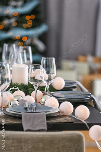 Table served for Christmas dinner in living room - 169499510