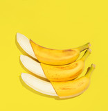 Fresh bananas on yellow background, view from above