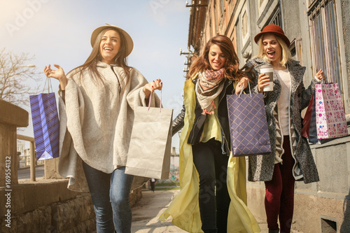 Friends having fun during shopping in the city.