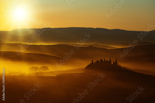 sun warm light on rolling hills in Tuscany Poster