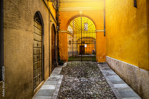 Foto op Canvas Smal steegje Old narrow colorful street in Parma, Italy.