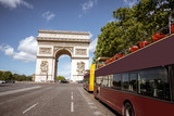View on the Triumphal arch and tourist buses during the sunny day in Paris